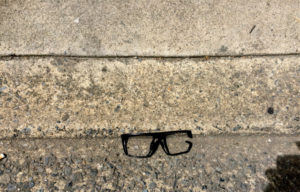 an empty frame for glasses sitting on the footpath
