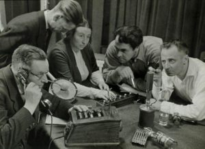 People recording a radio play - black and white photo